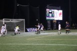 Senior defender Jake Roberge pokes a ball into the goal, the Wildcats' first of the night.